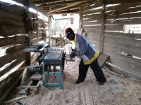 Tanzanian carpenter working in his workshop.