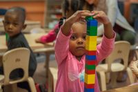 A student at the Cummings early childhood school works with building blocks.