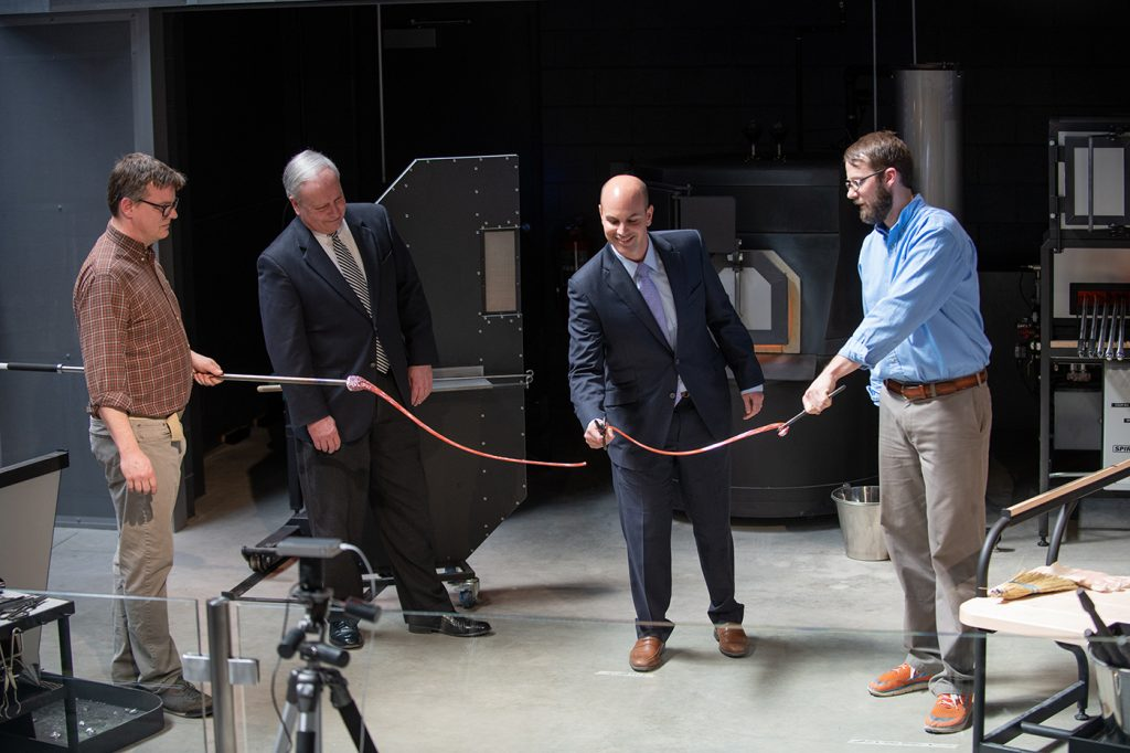 Cutting a ribbon made of molten glass, Mott Foundation President Ridgway White welcomed the community on April 21 to the FIA's new Contemporary Craft Wing and Hot Shop.