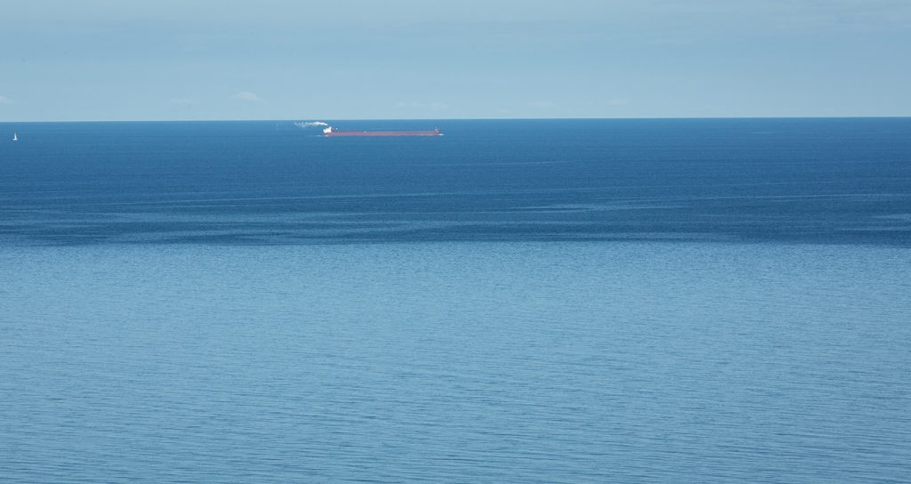 A freighter heads north in Lake Michigan, offshore of Arcadia Dunes.