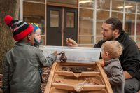 A teacher works with students at Cummings Great Expectations, one of two early childhood schools Mott helped to launch in the wake of the Flint water crisis.