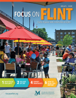Focus on Flint cover features a colorful outdoor scene filled with umbrellas at tables and people walking around outside the Flint Farmers' Market