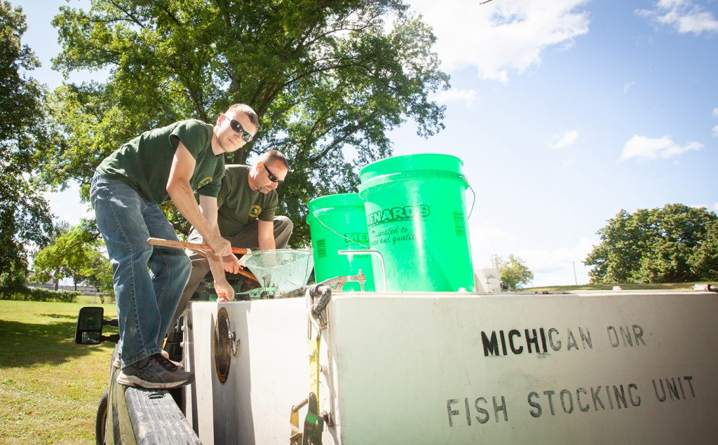 Flint River Watershed Coalition in conjunction with the Department of Natural resources restock the Flint River with sturgeon from buckets.