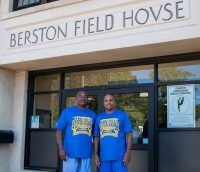 Two Berston Filed house men's basketball players stand at the entrance of the Berston Filed House in Flint, Michigan on July.