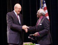 Welcoming Archbishop Desmond Tutu in Flint — 2007.